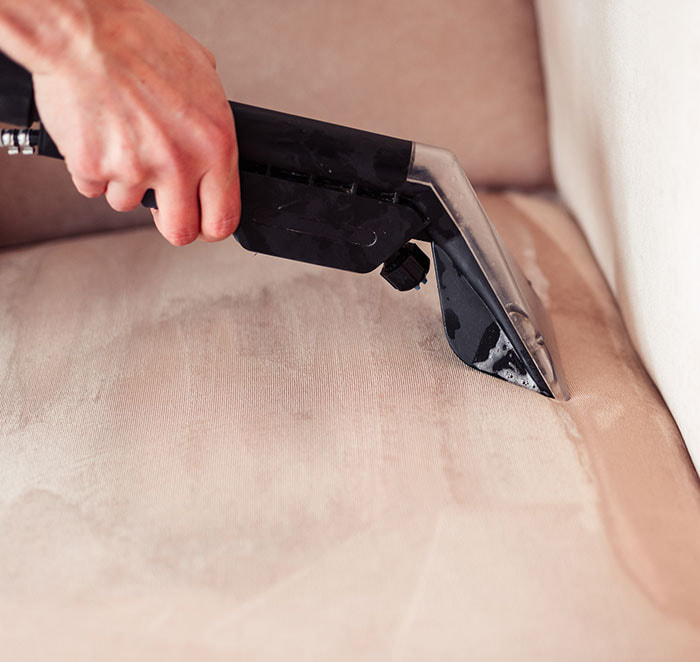 close up of cleaning nozzle on sofa